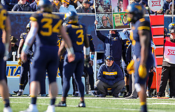Nov 10, 2018; Morgantown, WV, USA; West Virginia Mountaineers defensive coordinator Tony Gibson kneels before a play during the first quarter against the TCU Horned Frogs at Mountaineer Field at Milan Puskar Stadium. Mandatory Credit: Ben Queen-USA TODAY Sports