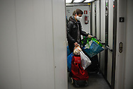 Aitor, a volunteer member of the Donostia Helping Network, takes  Rosario and Blanca's trash as he goes to buy some food for them. Both of them are confinated at home. Donostia (Basque Country). April 7, 2020. (Gari Garaialde / Bostok Photo)