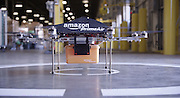 Amazon announces delivery by DRONE: Online retailer claims airborne robots will bring packages to your door in 30 minutes <br /> <br /> Amazon has unveiled its secret research project which it claims will be the future of home delivery - packages delivered by drones.<br /> <br /> The Internet shopping giant's chief executive Jeff Bezos says that he wants to use octocoptors to replace postmen and cut delivery times to just 30 minutes.<br /> <br /> Customers would have their order dropped onto their front lawn by the machine which would fly through the air from a nearby warehouse with it clasped in a metal grabber.<br /> <br /> It is not clear if the drones are a PR stunt or a serious proposition, but speaking to US TV network CBS, Bezos said: 'I know this looks like science fiction. It's not.'<br /> <br /> Bezos' claims raise the prospect of a future where drones whiz across the sky all the time ferrying post around - and perhaps one day even letters too. <br /> <br /> In the interview Bezos said that the drones would be able to carry goods up to five pounds in weight, which covers 86 per cent of the items that the company delivers.<br /> <br /> Bezos said that he wants to launch the 'Amazon Prime Air' service within four to five years, though that will almost certainly be in the US before anywhere else.<br /> <br /> He said: 'These generations of vehicles, it could be a ten-mile radius from a fulfillment (delivery) center.<br /> <br /> 'So, in urban areas, you could actually cover very significant portions of the population.<br /> <br /> 'And so, it won't work for everything; you know, we're not gonna deliver kayaks or table saws this way. These are electric motors, so this is all electric; it's very green, it's better than driving trucks around. This is all an R&D project'.<br /> <br /> Bezos said that the octocoptors would be autonomous so would not need a pilot to guide them.<br /> <br /> Instead they would use GPS tracking to find their way to and from the addre