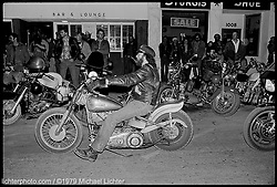 Bobber at the Bar & Lounge, Sturgis, SD. 1979<br /> <br /> Limited Edition Print from an edition of 50. Photo ©1979 Michael Lichter<br /> <br /> The Story:With its powerful direct flash, I'm reminded of old newspaper and police evidence photographs from the 40's or 50's. It looks like it could have been taken during the Hollister incident of 1947, but this was Sturgis 1979 when Gunners Lounge was at the center of it all. Funny - I feel too young to have taken it.