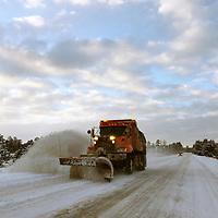 A crew with the NM Department of Transportation spent Jan. 1 plowing New Mexico Highway 53. In this photo a truck is seen plowing a section of N.M. 53 along El Malpais National Monument.