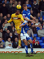 Photo: Ashley Pickering.<br />Ipswich Town v Burnley. Coca Cola Championship. 02/12/2006.<br />Ipswich's Richard Naylor beats Gifton Noel Williams to a header