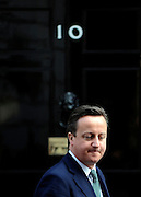 © Licensed to London News Pictures. 21/03/2012. Westminster, UK. British Prime Minister David Cameron leaves Downing Street on Budget Day on March 21, 2012. The Chancellor is expected to raise the amount of money people can earn before income tax takes hold and impose a new levy on the purchase of expensive homes. Photo credit : Stephen SImpson/LNP