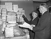 27/11/1956<br /> 11/27/1956<br /> 27 November 1956<br /> <br /> Mrs F E Hackett, Vice Chairman of the Irish Red Cross, receiving Clothing for Hungarian Refugees from Mr Hall, President of Irish Manufacturers Association