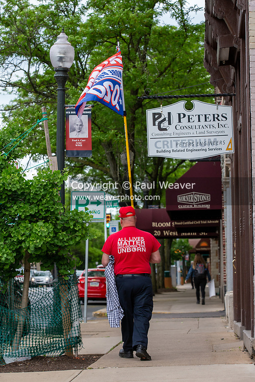 David McElwee brought a Trump 2020 flag to Bloomsburg's Market Square where he was the lone counter-protester. Across the street several hundred people gathered to protest police violence and racism.