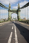 After being closed indefinitely to all traffic due to structural faults, an empty road over Hammersmith Bridge, on 11th April 2019, in west London, England. Safety checks revealed critical faults and Hammersmith and Fulham Council has said its ben left with no choice but to shut the bridge until refurbishment costs could be met. The government has said that between 2015 and 2021 its is providing £11bn of support to the 132-year-old bridge.
