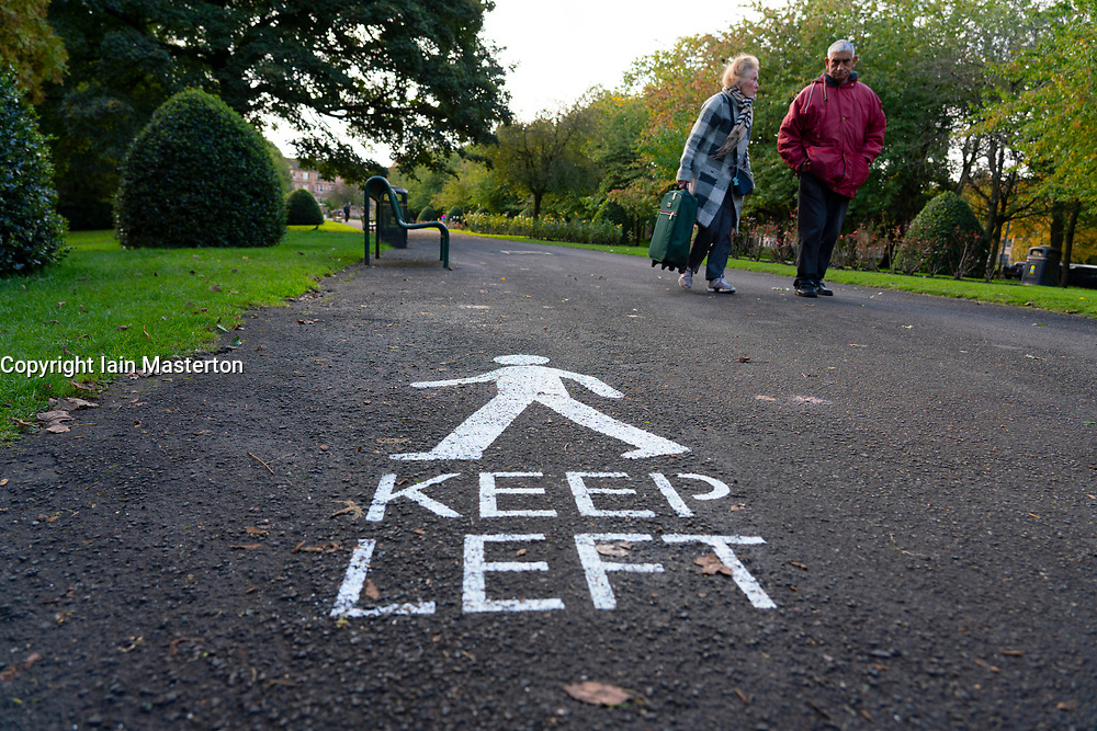 Glasgow, Scotland, UK. 7 October 2020. Time Out magazine has named Dennistoun in the East End of Glasgow as one of the world's coolest districts. Pictured; Covid-19 signs in Alexandra Park.  Iain Masterton/Alamy Live News