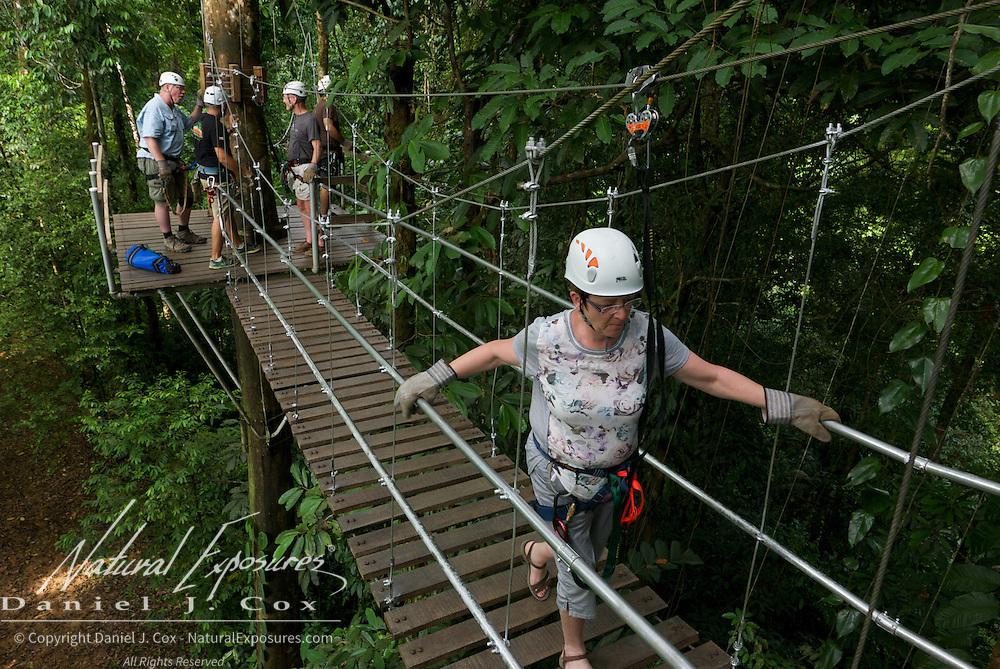 Heather on suspension bridge during zip line run. Costa Rica.