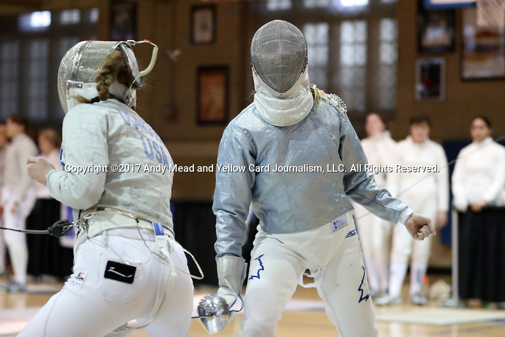 12 February 2017: Duke's Lindsay Sapienza (right) and Boston College's Laura Donovan (left) during Saber. The Duke University Blue Devils hosted the Boston College Eagles at Card Gym in Durham, North Carolina in a 2017 College Women's Fencing match. Duke won the dual match 19-8 overall, 6-3 Foil, 5-4 Epee, and 8-1 Saber.