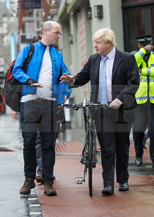 © Licensed to London News Pictures. 27/05/2014. London, UK. Mayor of London, Boris Johnson with Cycling Commissioner for London, Andrew Gilligan at an Operation Safeway road safety event held at the junction of Tooley Street and Tower Bridge Road in London on 27th May 2014. A seven week pilot of Operation Safeway was carried out late last year in response to a series of tragic cyclist and pedestrian deaths on London's roads, where Police officers were deployed at key junctions across the capital, enforcing road safety and giving advice to road users during rush hours. Operation Safeway will now continue at key junctions across London to build awareness and promote safety for all road users. Photo credit : Vickie Flores/LNP