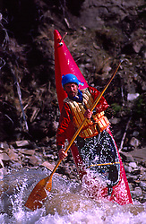 Kayaker Steve Horn does ender on the Snake River in Jackson Hole Wyoming.