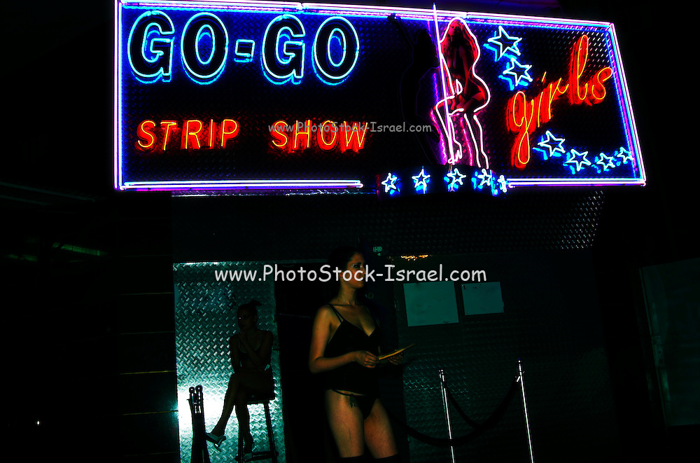 two erotic dancers waiting outside the club for the first customers of the night