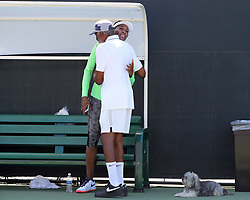 March 23, 2018 - Key Biscayne, Florida, United States Of America - KEY BISCAYNE, FL - MARCH 23: Richard Williams shows his daughter a rare moment of PDA as he hugs her on the practice court on day 5 of the Miami Open at Crandon Park Tennis Center on March 23, 2018 in Key Biscayne, Florida. ...People:  Venus Williams, Richard Williams. (Credit Image: © SMG via ZUMA Wire)