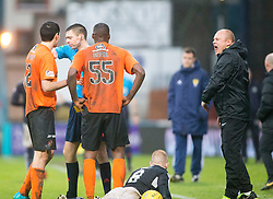 Ref Kevin Clancy gives Dundee United's Guy Demel a red card after he tackled Dundee's Nicky Low. Dundee United's manager Mixu Paatelainen not too happy. Dundee 2 v 1  Dundee United, SPFL Ladbrokes Premiership game played 2/1/2016 at Dens Park.