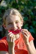 Young girl enjoys a Pitaya (AKA dragon fruit)