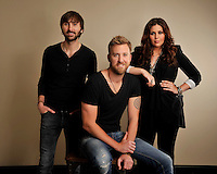** HOLD FOR STORY ** Lady Antebellum poses for portraits on Friday, March 22, 2013 in Nashville, Tenn. (Photo by Donn Jones/Invision/AP)