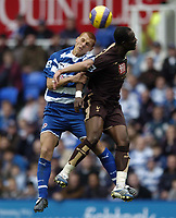 Photo: Jonathan Butler.<br /> Reading v Tottenham Hotspur. The Barclays Premiership. 12/11/2006.<br /> Steve Sidwell of Reading jumps for the ball with  Didier Zokora of Tottenham.