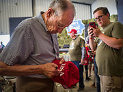 "15 JUNE 2019 - BOONE, IOWA: US Senator CHUCK GRASSLEY (R-IA) signs an autograph at ""Joni's Roast and Ride,"" an annual fund raiser held by US Senator Joni Ernst (R-IA). Ernst, Iowa's junior US Senator, kicked off her re-election campaign during the ""Roast and Ride"", an annual fund raiser and campaign event has she held since originally being elected to the US Senate in 2014.   PHOTO BY JACK KURTZ"