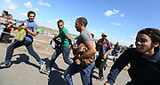 Migrants run to try and escape being contained by police close to the Hungarian and Serbian border town of Roszke, Hungary, September 7 2015. The UN's humanitarian agencies are on the verge of bankruptcy and unable to meet the basic needs of millions of people because of the size of the refugee crisis in the Middle East, Africa and Europe, senior figures within the UN have told the media.