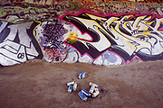 Spray cans and graffiti under a bridge along the LA River in the Sepulveda Basin Wildlife Area. San Fernando Valley, California, USA