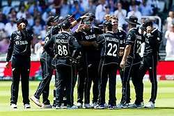 Lockie Ferguson of New Zealand and Martin Guptill of New Zealand celebrate with teammates after combining to take the wicket of Steve Smith of Australia  - Mandatory by-line: Robbie Stephenson/JMP - 29/06/2019 - CRICKET - Lords - London, England - New Zealand v Australia - ICC Cricket World Cup 2019 - Group Stage