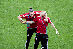 LYON, FRANCE - Tuesday, July 5, 2016: Wales' Gareth Bale and Jonathan Williams during a training session ahead of their UEFA Euro 2016 Championship Semi-Final match against Portugal at the Stade de Lyon. (Pic by Paul Greenwood/Propaganda)