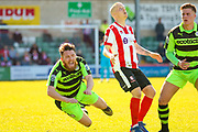 Forest Green Rovers midfielder Sam Wedgbury (8) is fouled during the Vanarama National League match between Lincoln City and Forest Green Rovers at Sincil Bank, Lincoln, United Kingdom on 25 March 2017. Photo by Simon Davies.