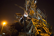 Children building a tower with wood they found in the orthodox distric of Mea Shearim for celebrate Lag BaOmer