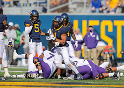 Nov 14, 2020; Morgantown, West Virginia, USA; West Virginia Mountaineers linebacker Tony Fields II (1) celebrates after a defensive stop during the second quarter against the TCU Horned Frogs at Mountaineer Field at Milan Puskar Stadium. Mandatory Credit: Ben Queen-USA TODAY Sports