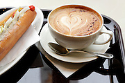 egg salad sandwich and a cappuccino coffee with a heart