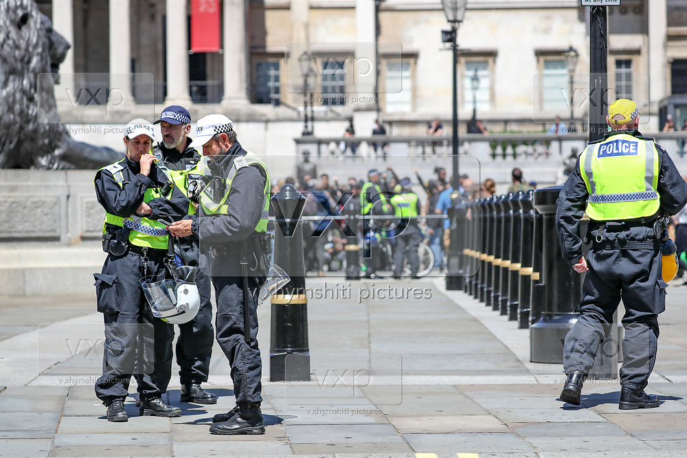 British police officers in riot gear form a cordon at Trafalgar Square in central London, as members of far-right groups gather to counter-protest against a Black Lives Matter demonstration, Saturday, June 13, 2020. British police have imposed strict restrictions on groups planning to protest in London Saturday in a bid to avoid violent clashes between protesters from the Black Lives Matter movement, as well as far-right groups. (Photo/ Vudi Xhymshiti)
