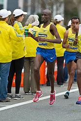 2013 Boston Marathon: Wesley Korir, defending champion, takes fluids at water station