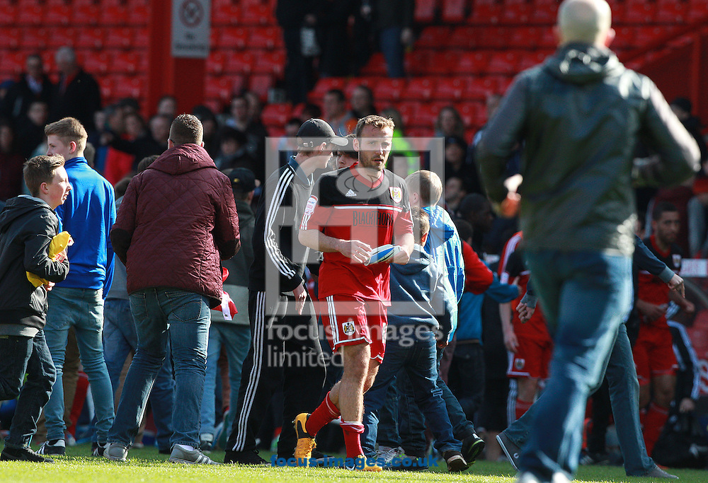 Picture by Paul Terry/Focus Images Ltd +44 7545 642257.27/04/2013.Liam Kelly ( C ) of Bristol City leaves the pitch after the game as fans run onto the pitch after the npower Championship match at Ashton Gate, Bristol.