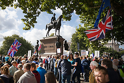 © Licensed to London News Pictures. 09/09/2017. London, UK. People gather below a statue of The Duke of Wellington for the start of the pro EU People's March For Europe in central London. Speakers including Sir Bob Geldof, Sir Ed Davey and Liberal Democrat leader Vince Cable will address a rally in Parliament Square. Photo credit: Peter Macdiarmid/LNP