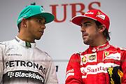 April 20, 2014 - Shanghai, China. UBS Chinese Formula One Grand Prix. Lewis Hamilton (GBR), Mercedes Petronas, Fernando Alonso (SPA), Ferrari