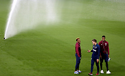 West Ham United players inspect the pitch prior to the match kick off