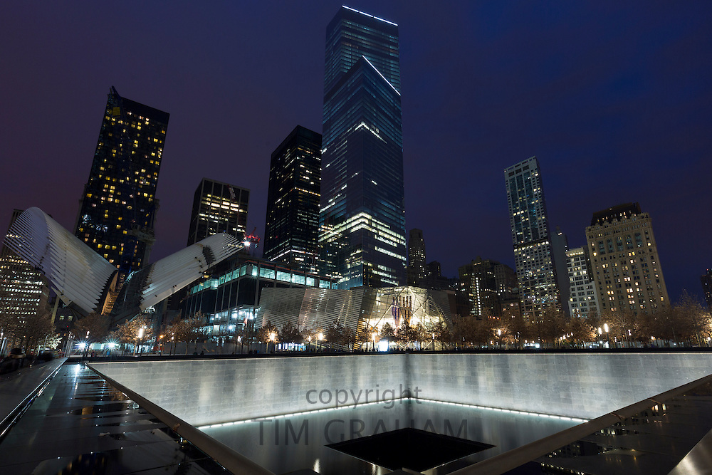 One World Trade Center complex site with museum and illuminated 9/11 Memorial North Tower Pool in New York, USA