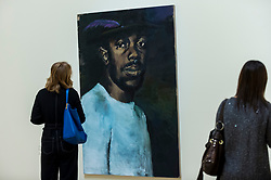 "© Licensed to London News Pictures. 02/12/2020. LONDON, UK. A visitor views ""Six Birds In The Bush"", 2015. Preview of ""Lynette Yiadom-Boakye: Fly In League With The Night"" the first major UK survey exhibition by British artist Lynette Yiadom-Boakye.  Over 70 of her works spanning two decades are on display at Tate Britain.  It is the first new exhibition at Tate since the galleries were re-opened after coronavirus lockdown restrictions were slightly eased by the UK government.  Photo credit: Stephen Chung/LNP"