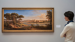 """© Licensed to London News Pictures. 04/12/2015. London, UK. A woman views """"Florence, a view of the city from the right bank of the river Arno looking towards the Ponte alla Carraia"""" by Gaspar van Wittel, called Vanvitelli (est. £1.0-1.5 million) ahead of Sotheby's London evening sale of Old Master and British paintings on 9th December 2015.  Photo credit : Stephen Chung/LNP"""