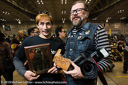 Italian Lowride publisher Giuseppe Roncen with the recipient of his Mooneyes award at the Annual Mooneyes Yokohama Hot Rod and Custom Show. Japan. Sunday, December 7, 2014. Photograph ©2014 Michael Lichter.