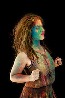 Woman with colorful holifest paint on her face. Holi is the festival of love or colors that signifies the victory of superior over immoral.