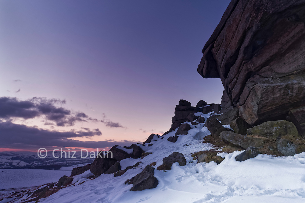 Crags at the southern end of Stanage Edge in winter snow at dusk