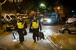 © Licensed to London News Pictures. 26/06/2020. London, UK. Police in riot equipment leave an illegal Street Party at Riverton Close in Maida Vale, West London.  A number of similar events have occurred across the capital, with some resulting in violence towards police. Photo credit: Ben Cawthra/LNP
