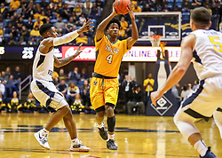 Nov 24, 2018; Morgantown, WV, USA; Valparaiso Crusaders guard Bakari Evelyn (4) passes the ball during the first half against the West Virginia Mountaineers at WVU Coliseum. Mandatory Credit: Ben Queen-USA TODAY Sports