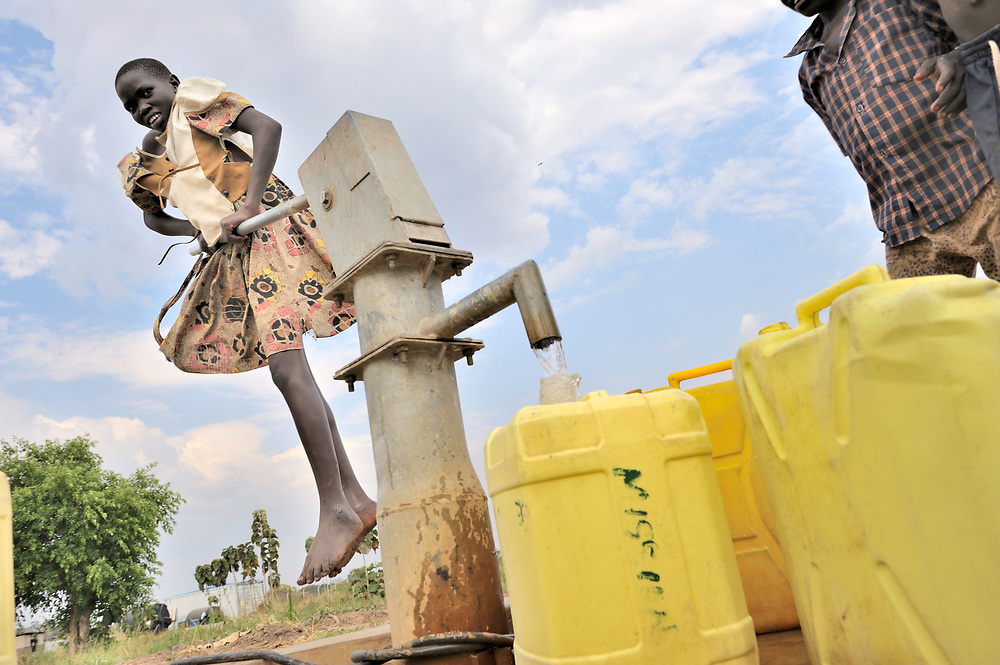 Children obtain water for their families from a well installed by the United Methodist Committee on Relief (UMCOR) in Yei, a town in Central Equatoria State in South Sudan.