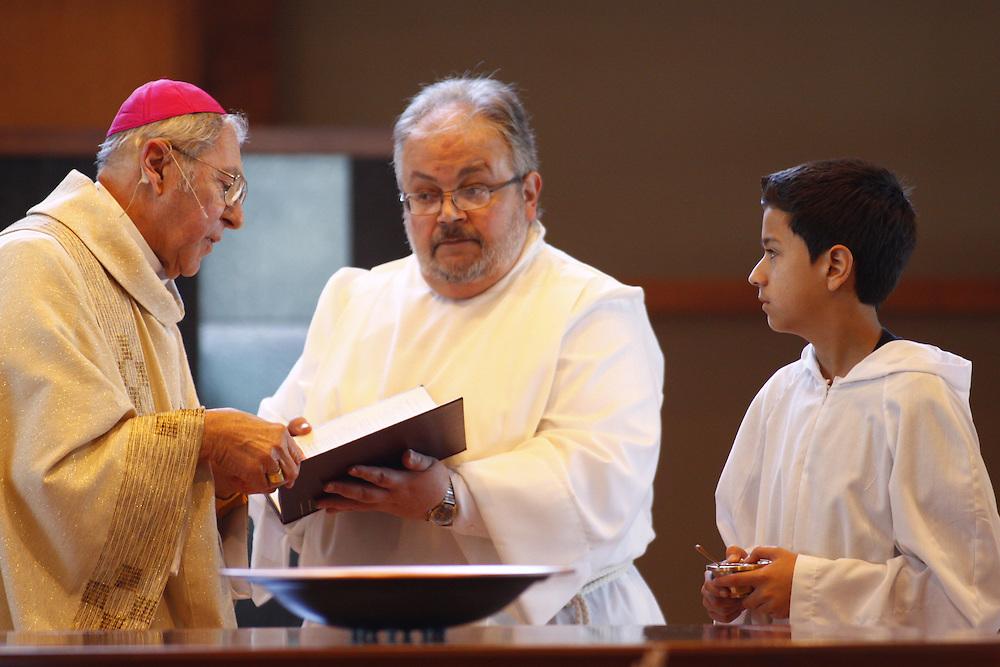 Bishop Richard J. Sklba anoints the alter Sunday, Nov. 22.