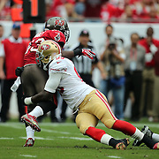 San Francisco 49ers outside linebacker Aldon Smith (99) tackles Tampa Bay Buccaneers running back Bobby Rainey (43)during an NFL football game between the San Francisco 49ers  and the Tampa Bay Buccaneers on Sunday, December 15, 2013 at Raymond James Stadium in Tampa, Florida.. (Photo/Alex Menendez)