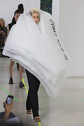 © Licensed to London News Pictures. 03/06/2015. London, UK. A model walks the runway at the Royal College of Art (RCA) MA Fashion graduate fashion show.  Photo credit : Bettina Strenske/LNP