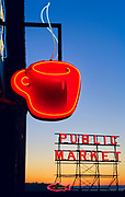 Coffee themed neon sign in Seattle, Washington<br /> .....<br /> Seattle is a major coastal seaport and the seat of King County, in the U.S. state of Washington. With 620,778 residents as estimated in 2011, Seattle is the largest city in the Pacific Northwest region of North America and the largest city on the West Coast north of San Francisco. The Seattle metropolitan area of around 4 million inhabitants is the 15th largest metropolitan area in the United States. The city is situated on a narrow isthmus between Puget Sound (an arm of the Pacific Ocean) and Lake Washington, about 100 miles (160 km) south of the Canada-United States border, but further north than Toronto.