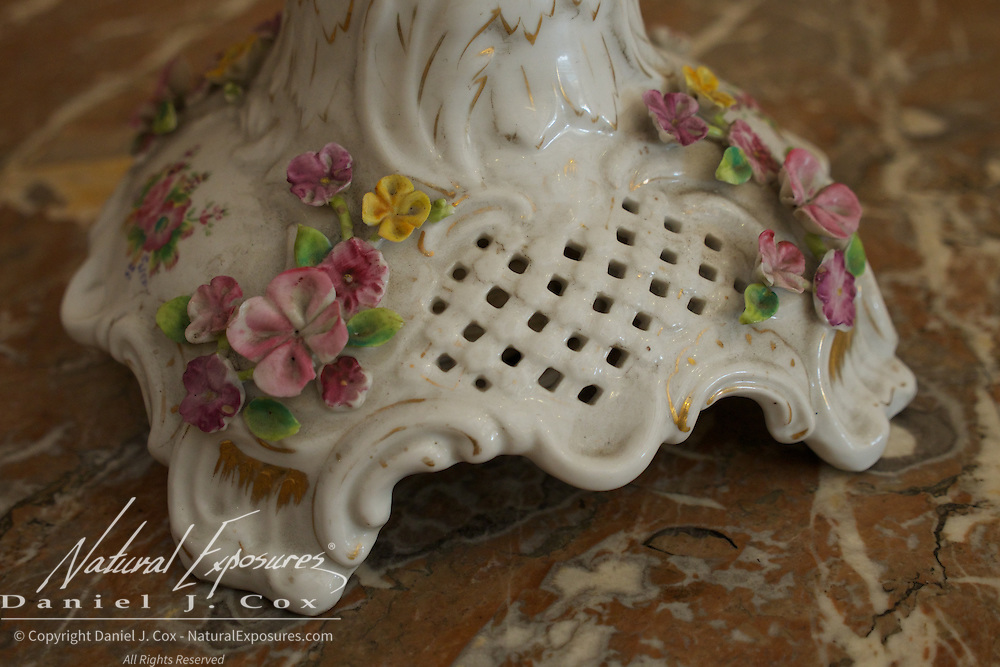 The base of very old lamp at the Wedding Palace in Havana, Cuba.